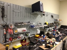 Wall Mountable Weapon Racks storing assorted parts & gear